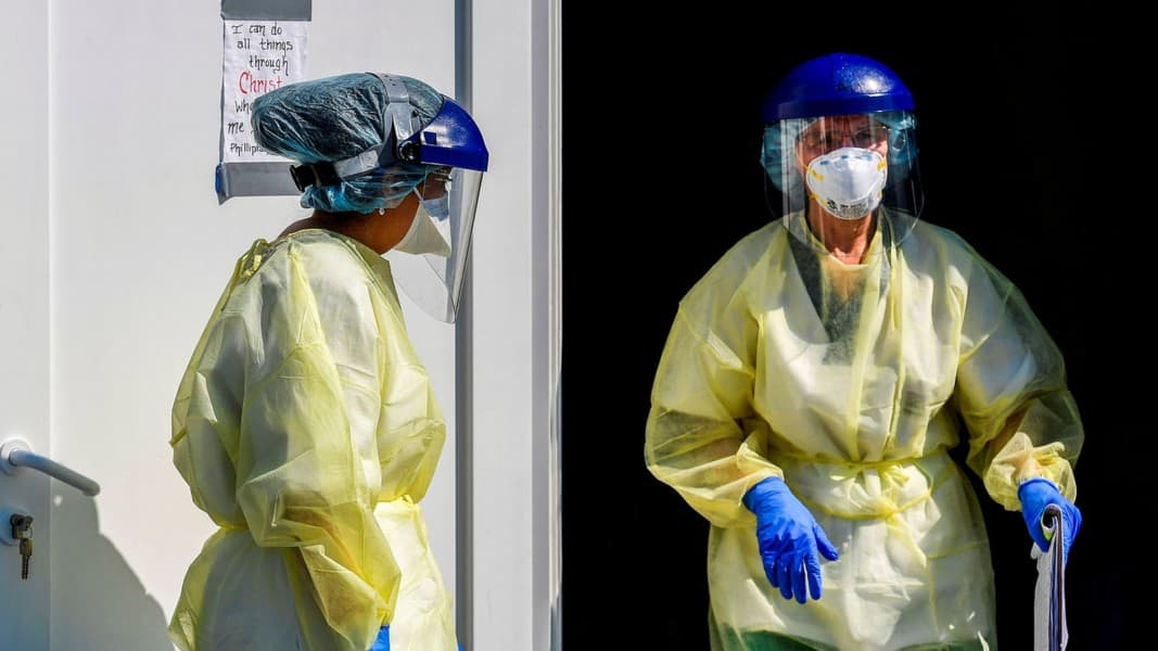 Americans Remain Divided On The Threat As Pandemic Worsens