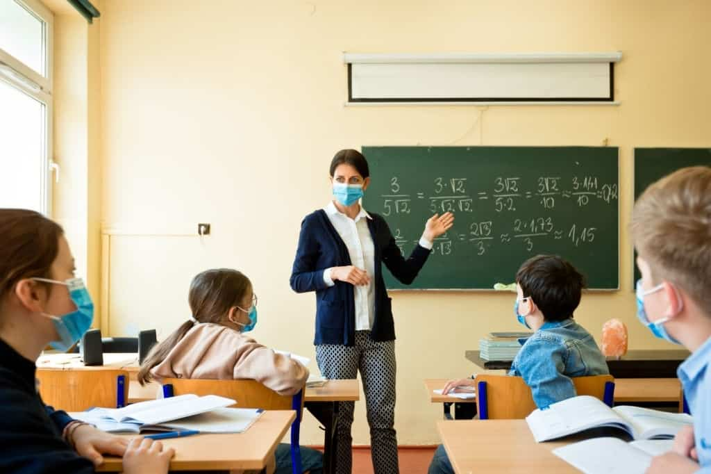 Pediatricians' Group: Keep Wearing Masks In Schools And On The Job